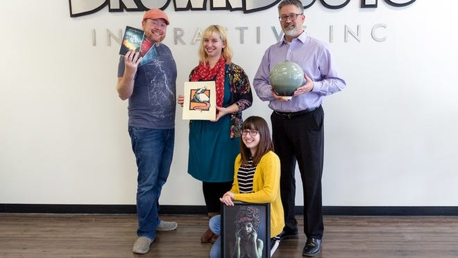 The pottery, digital art, illustration and fiction of BrownBoots Interactive, Inc. employees will be on display at Tour the Town Art Walk on Friday, Dec. 15, at Riverwalk Art Center. Pictured are, from left: David Michael Williams, Samantha Nelson, Mary Christopherson and Alan Hathaway.