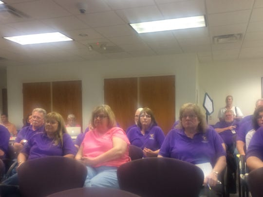 Johnston school bus drivers listen as the school board votes on privatizing its transportation system.