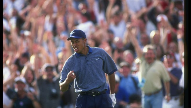 Tiger Woods celebrates after making a hole in one during the Phoenix Open at the TPC Scottsdale in Scottsdale on Jan. 25, 1997.