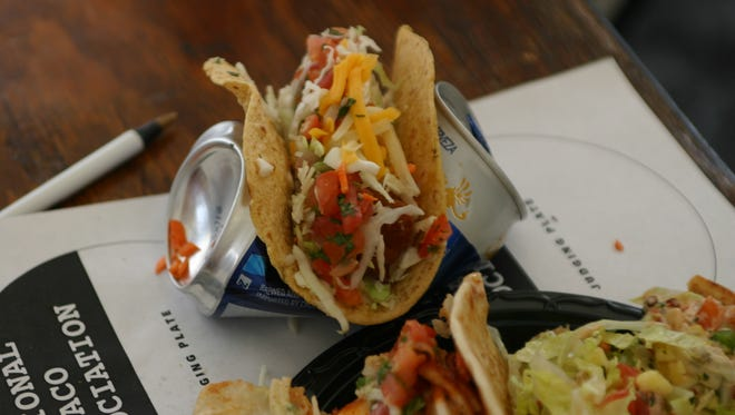 The taco entries at the Arizona Taco Festival are very creative, such as this one, presented on a crumbled beer can.