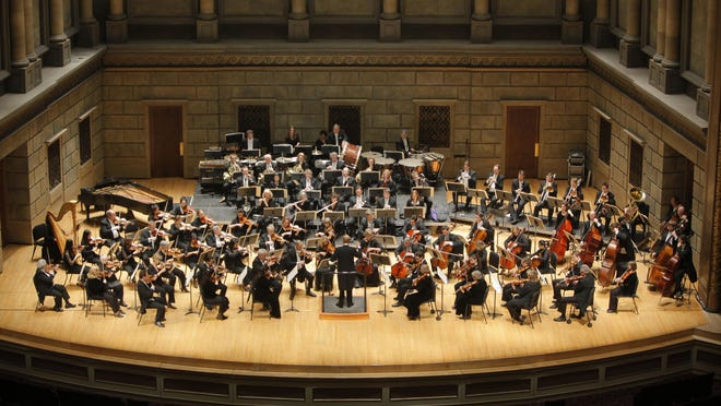 The Rochester Philharmonic Orchestra practices in the Eastman Theatre in this April 14, 2010 photo.