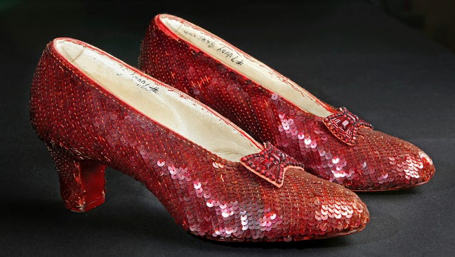 "File- This Nov. 9, 2001, file photo shows the sequin-covered ruby slippers worn by Judy Garland in ""The Wizard of Oz""  at the offices of Profiles in History in Calabasas, Calif. Smithsonian Museum officials started a Kickstarter fundraising drive Monday, Oct. 17, 2016,  to repair the iconic slippers from 1939's ""The Wizard of Oz"" and create a new state-of-the-art display case for them at the National Museum of American History.  (AP Photo/Reed Saxon, File)"
