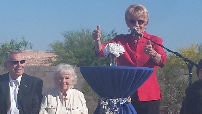 Phoenix City Councilwoman Thelda Williams speaks at Bayer Private School's groundbreaking ceremony with Erwin and Tedii Freesmeyer, the founders of Rancho Solano school, seated.