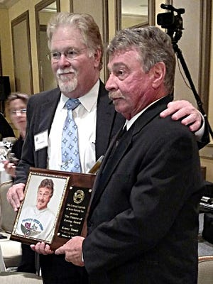 Westmoreland native Kenneth Troutt (at right) accepts the Pioneer of Racing Award from NASCAR Hall of Fame historian Buz McKim during Wednesday's Living Legends of Auto Racing Banquet, which was held in Daytona Beach, Fla.