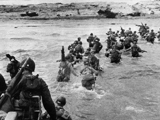 UTAH BEACH, FRANCE:  U.S. troops disembark from landing