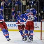 The Rangers celebrate after beating the Canadiens 1-0 in Game 6 of the Eastern Conference finals.