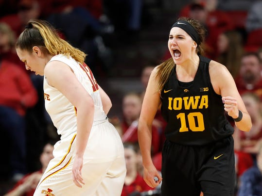 FILE - In this Dec. 6, 2017, file photo, Iowa forward Megan Gustafson (10) celebrates in front of Iowa State forward Bride Kennedy-Hopoate, left, during the second half of an NCAA college basketball game, in Ames, Iowa. Judging by her stats, Iowa junior center Megan Gustafson might be the best player in America. Unfortunately for Gustafson and the Hawkeyes, not many people see it that way. (AP Photo/Charlie Neibergall, File)