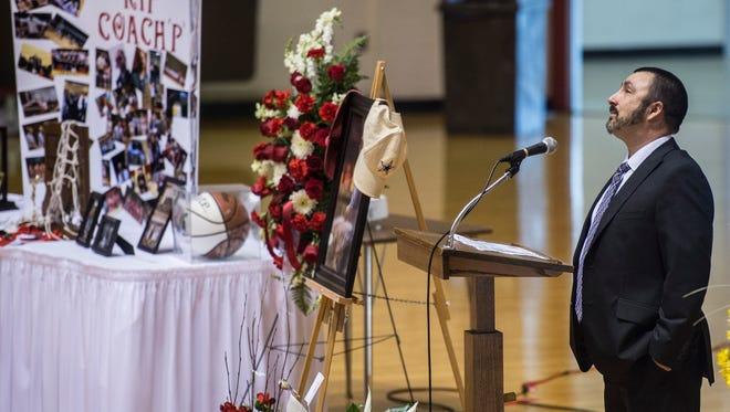 Shane Hillard speaks during a memorial service for Richmond High School girls basketball coach Casey Pohlenz at the Tiernan Center on Monday, June 4, 2018. Hillard, a former assistant for Pohlenz, was announced as Richmond's new girls basketball coach Wednesday, June 27, 2018.