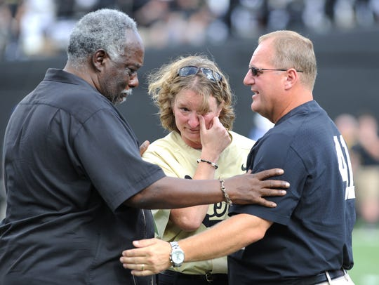 Vanderbilt athletic director David Williams comforts