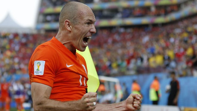 Netherlands' Arjen Robben celebrates after his team scored their second goal during the group B World Cup soccer match between the Netherlands and Chile at the Itaquerao Stadium in Sao Paulo, Brazil, Monday, June 23, 2014. The Dutch team beat Chile 2-0 to top Group B.