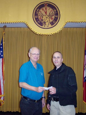 "The Mountain Home Elks lodge #1714 recently presented a $350 check to the Mountain Home Fraternal Order of Police Lodge #45 to assist with the ""Shop with a Cop"" event for underprivileged children. Shown are (from left) Don Swanson, Elks president; and Sgt. Tom Canta, FOP president."