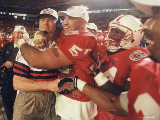 Coach Tom Osborne, right, and defensive tackle Jason Peter celebrate the Huskers' win over Tennessee in the Orange Bowl following the 1997 season. Nebraska and Michigan shared the national championship.