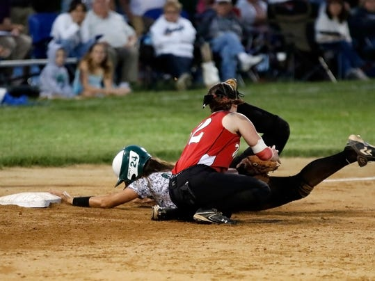 Twin Valley's Emily Webster beats the throw and tag by Susquehannock's Kelly Rogers at Twin Valley Middle School during Tuesday's District 3 Class AAA softball tournament. The Raiders won, 15-4.