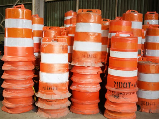 State may pay big bucks for brighter orange barrels
