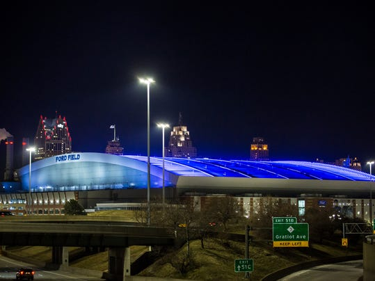 In this Thursday, Feb. 9, 2017 photo, Ford Field Lights Ford Field in Detroit, is bathed in blue lights. More than 850 people have signed a petition asking for Detroit's NFL stadium to turn off its blue nighttime roof lighting. Many who signed the petition are complaining about the light's negative impact on nighttime drivers. (Salwan Georges/Detroit Free Press via AP)