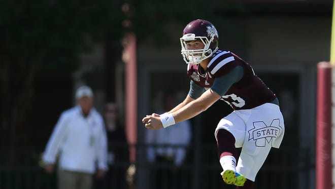 Mississippi State's Logan Cooke had to fill in for Devon Bell against No. 6 Texas A&M in 2014.