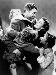 Jimmy Stewart, top with child on back, and Donna Reed, looking up at him, star in the classic holiday film, 'It's a Wonderful Life.'