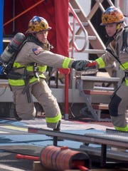 Firefighters compete during the Firefighter World Combat Challenge in downtown Montgomery, Ala., on Monday October 24, 2016. The competition runs through Saturday.