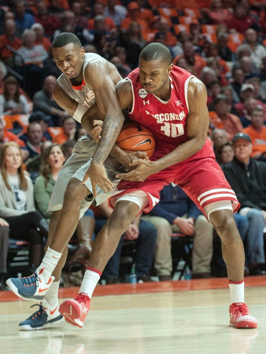 Illinois forward Leron Black and Wisconsin forward Vitto Brown (30) tangle over a loose ball during the first half of an NCAA college basketball game in Champaign, Ill., Tuesday, Jan. 31, 2017. (AP Photo/Rick Danzl)