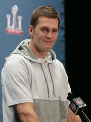 Tom Brady answers questions during Super Bowl LI media availability at the J.W. Marriott on Feb. 2, 2017 in Houston.