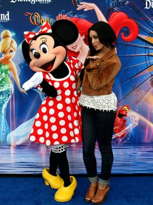 Disney star Vanessa Hudgens appears  with Minnie Mouse  in June 2010 to promote a new attraction at Disneyland.