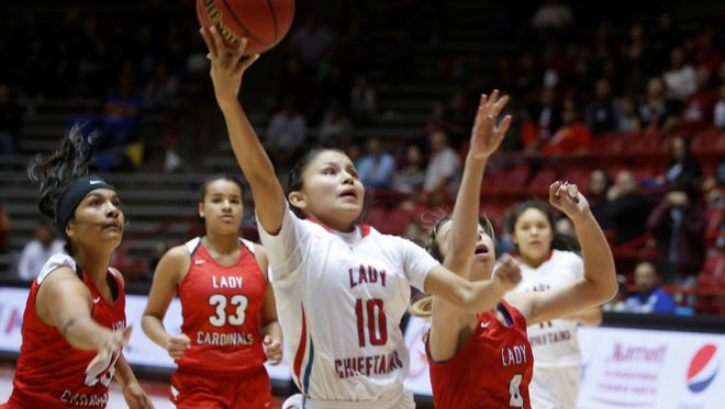 Shiprock's Melanie Secody soars to the rim against Robertson on Thursday at The Pit in Albuquerque.