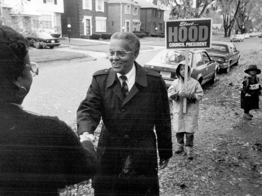 Detroit council member Nicholas Hood campaigns outside a polling place near 7 Mile and Greenlawn in November 1989 with two of his grandchildren, Nathan Hood, 7, and Noah Hood.