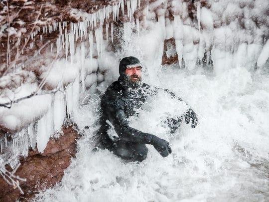Daniel Schetter, 37, of Marquette surfs recently in