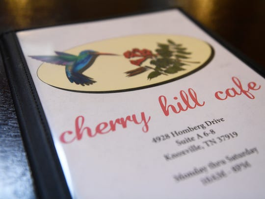 A Cherry Hill Cafe menu rests on the restaurant's counter,