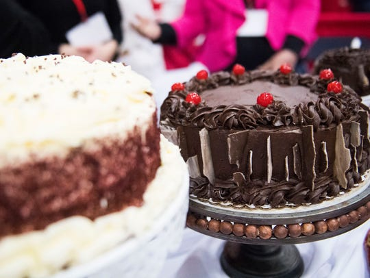 Cakes from Sweet Shoppe Bakery sit on a table at Chocolatefest 2018.