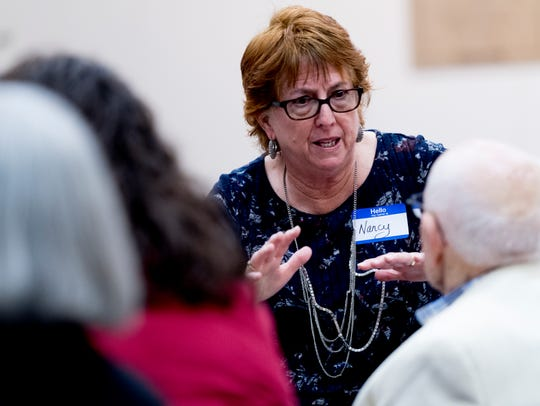 Leader Nancy Reinecke chats with attendees during the