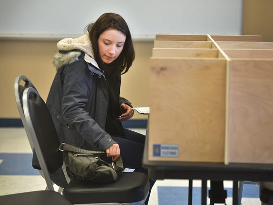 Alma Sehovic sits down to vote in the Mayoral and City