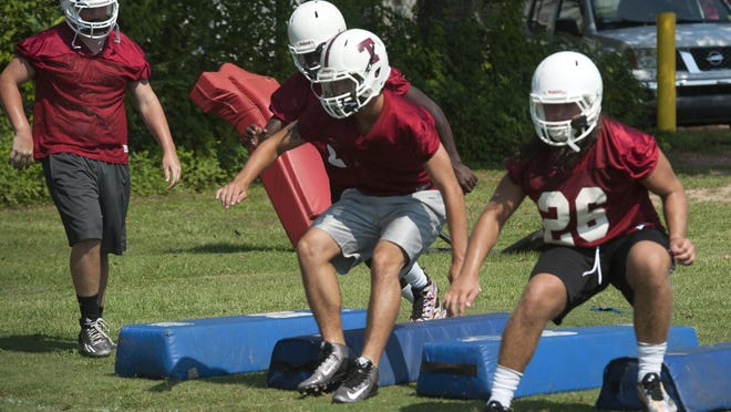 The Tate High School football team prepares for the 2015 prep football season with a light practice Monday morning.