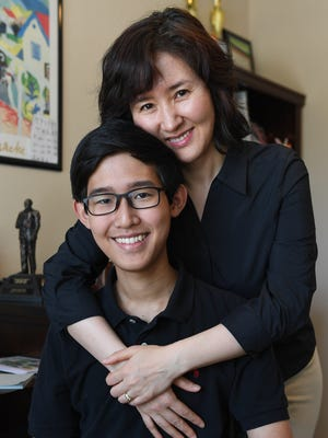 Southside High student Brendon Lee with his mother Hiewon Shin at their home in Greer on Monday, May 29, 2017. Lee was diagnosed with leukemia early in 2014, but has never let it slow him down.