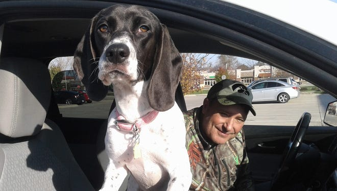 Brad Frantz of North Liberty allows his rescue dog, Maggie, a front seat berth from time to time for short-errand trips. He is teaching her to sit calmly and enjoy the view.