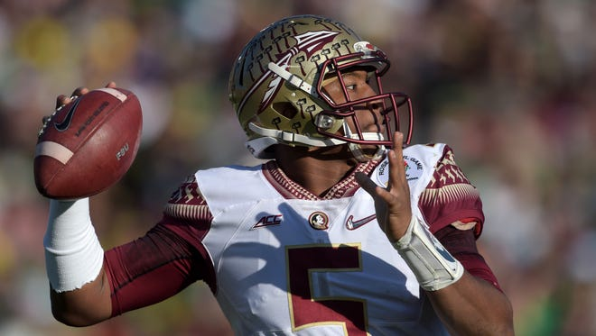 Jameis Winston drops back to pass.
