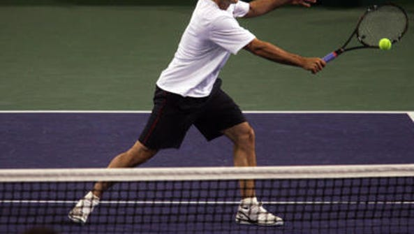 Pete Sampras in action during the Hit for Haiti charity