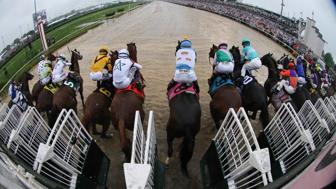 Horses leave the starting gate for Derby 144 at Churchill Downs.