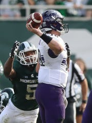 Michigan State Spartans linebacker Andrew Dowell rushes
