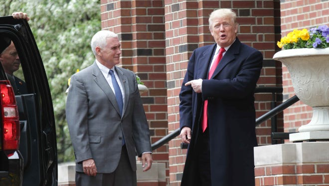 Indiana Governor Mike Pence and Donald Trump took a few questions from the press after meeting at the Governors residence for around an hour before Trump left for his rally at the Indiana State Fairgrounds on April 20.