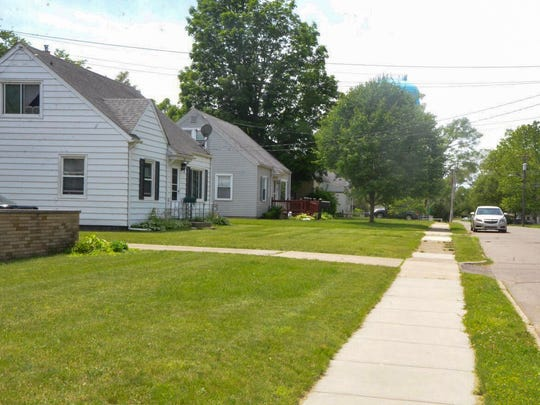 A row of houses on Kellogg Street showcases the green lawns and quiet neighborhoods of Battle Creek. The housing market in the city is currently heavily in favor of people who are selling their houses.