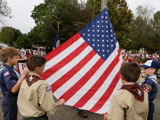 Boy Scouts raise the flag during the Annual Patriotic