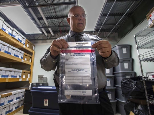 Colchester Police Detective Keith Schaffer shows a tamper-proof evidence bag in the police department's evidence room on Tuesday, November 3, 2015.  The bag is one part of a new evidence-handling protocol adopted by the department in the wake of former Det. Tyler Kinney's theft of drugs from the evidence room.