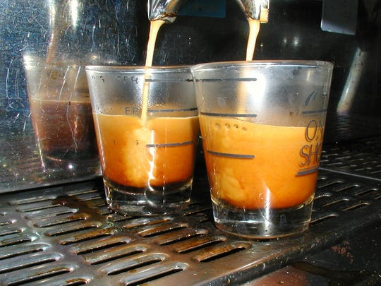 A couple of shots of espressos in progress. Each weighs about an ounce.