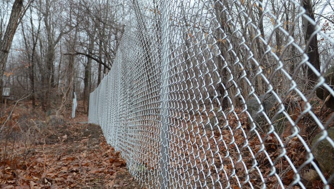 The Borough of Ringwood is fencing up land between Horseshoe Bend and Margaret King roads, as seen on Jan. 4. Officials say the property is prone to sinkholes.