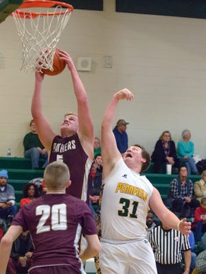 Parma Western's Steele Fortress (5) goes up for a rebound against Pennfield's Matthew Romig (31) on Friday.