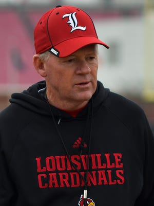 Head coach Bobby Petrino looks on during the University of Louisville's first spring football practice on the practice fields aside Papa John's Cardinal Stadium.