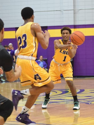 LSU of Alexandria's DeAngelo Coleman (1, right) passes to Jordin Williams (23, left) against LSU of Shreveport Tuesday.