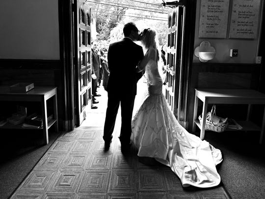 Anthony D'Ambrosio, 29, of Wall shares a kiss with his former wife on their 2012 wedding day.