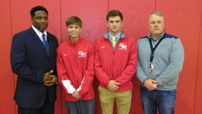 Glen Ridge wrestling (from left) coach Kendall Southerland, team captains Nick Fiorillo and Joe Marchesano and assistant coach Carl Houser.